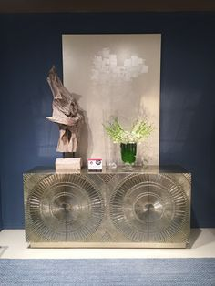 The Barcelona Console by Bernhardt is a showstopper! It can be used as a console or buffet. It's finished in German Silver, a new metal finish we saw lots of this market. The piece is carved out of teak wood and then sheets of metal are hammered into the design. The hardware integrates seamlessly into the large emblem on the front of the design.