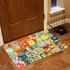 "floorcloth by craftapple, via Flickr - made with 3 layers of fabric held together with Mod Podge and ""Rug Backing"" that you paint on the back to keep from slipping."