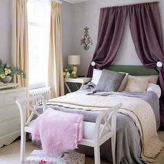 I like the hunter green headboard with the purple and grey theme. I also dig the purple curtain above the bed.