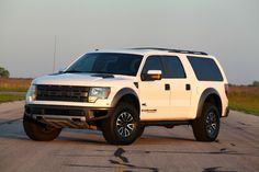 Hennessey VelociRaptor 600 SUV, 30 units/yr. to be produced, 0-60: 5.9 seconds, top speed not listed, current pricing starts at $149,500 according to Henessey's press release.  I have to say it's beautiful, and if I do ever hit the lotto I'd order one...
