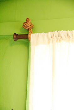 such a cute & clever idea for a nautical curtain rod!