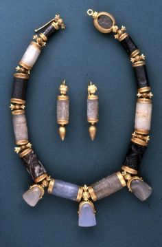 A 19th century jewellery set made from Assyrian and Babylonian cylinder and stamp seals, belonging to Lady Layard.    The seals date from anywhere between 2000 and 600 B.C., the gold mounting from the late 1800s.    This practice, where ancient artefacts, when pretty enough, were reused as jewellery, was prevalent in the late 19th and early 20th century.     (Source: The British Museum)