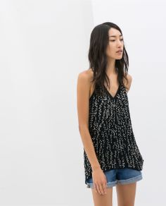 Zara http://www.zara.com/us/en/woman/shirts/top-with-sequins-c358004p1667220.html
