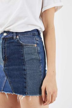 A cool spin on the classic denim skirt, this style comes in a patchwork design. Sitting high on the waist, it is cut in a cute mini fit. Style with a plain white tee for a totally effortless look. #Topshop