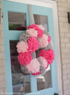 Love the way this DIY pom wreath turned out. The perfect welcome to your party.