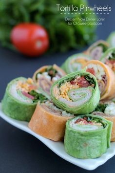 When I make something for a party, I like to go for something visually appealing and equally delicious.  These tortilla pinwheels are perfect for that!  The colors are vibrant thanks to the flavored tortillas, which are filled with distinct flavors like bold spicy mayo, juicy tomatoes, savory cheddar cheese, & crisp lettuce.  You are basically building a sandwich within a wrap, rolling it tight and slicing it into perfect little party portions.
