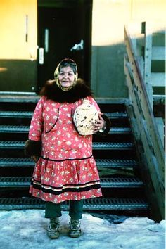 Yupik woman with basket, representing 20,000 Yupik people who live in Alaska (largest Native group)