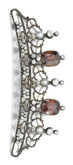 *ZIRCON, PEARL, ENAMEL AND DIAMOND BROOCH/ HAIR ORNAMENT, CARLO GIULIANO, CIRCA 1880 Of open work design, set with cushion-shaped zircons of brown tint, pearls, accented with circular-cut diamonds, the frame decorated with black enamel with white enamel highlights, maker's mark C.G, detachable brooch fitting.  #ZirconTiara