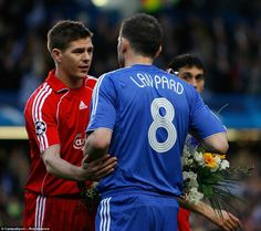 Gerrard hands international team-mate Lampard a bouquet of flowers following the death of his mother, Pat, in April 2008