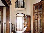 long foyer with hardwood floor