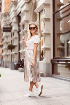Linda Juhola in white All Saints t-shirt, Zara pleated rose gold skirt, Chanel bag and white Adidas sneakers