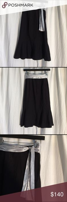 Yves Saint Laurent rive gauche black silk skirt Yves Saint Laurent black 100% silk skirt with gray satin tie.  I'm not sure if this is the size but it's the only thing I could find and this fits like an extra for extra extra small. (36?) Yves Saint Laurent Skirts