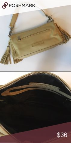 BCBG Maxazria leather handbag Butter soft leather BCBG Maxazria purse in a buttery tan / ochre yellow shade. Great condition! 👝On trend leather double tassels on each side of handbag.  👝Zippered cell phone pocket on front & additional zip pocket on back.  👝Logo embossed fabric lining with zip pocket inside.  👝Wide shoulder strap designed for comfort can be unsnapped if you want to carry as a clutch. BCBGMaxAzria Bags