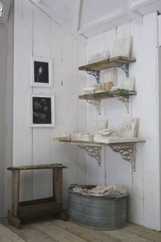 I like the shelf brackets, I like the hamper idea. I like the white walls...I like, like, like