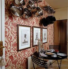 Alex Papachristidis ~ In the small kitchen 19th century neo-classical prints are displayed against Nina Campbell's Tamarin wallpaper