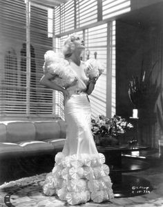 """Carole Lombard in """"The brief moment"""". Costumes by Robert Kalloch. 1933. As part of the advertising, Columbia Pictures changed the dress to red."""