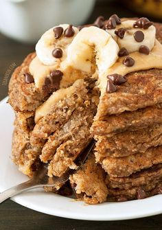 These banana pancakes are gluten-free, 100% whole grain, and dairy-free! They use ground up oats instead of flour which results in some awesome non-healthy tasting pancakes!   texanerin.com