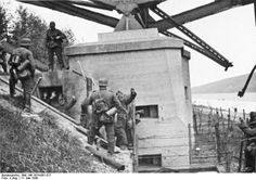 German troops take 30 prisoners from the bunker under the south side of the Veldwezelt bridge over the Albert Canal :11th May 1940 10am