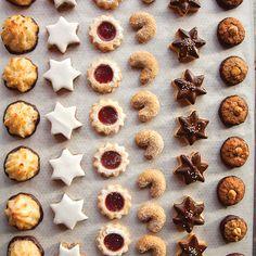 German Christmas Cookies--Kokosmakronen (Chocolate Macaroons) Zimtsterne (Cinnamon/Kirsch) Spitzbuben (Raspberry Jam Filled) Vanillekipferl (Aniseseed Crescents) Schokiladen-Butter-plaetzchen (Chocolate Shortbread) and Nusstaler (Chocolate Hazelnut)! German Christmas Cookies, German Cookies, Christmas Sweets, Christmas Cooking, Holiday Cookies, Holiday Treats, Holiday Recipes, Christmas Foods, Christmas Recipes