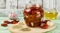 Olive oil, garlic and dried herbs add savory hits of flavor to plumped-up sun-dried tomatoes. Dried Orange Peel, Dried Oranges, Dried Cherries, Marinated Tomatoes, Dried Tomatoes, Garlic Infused Olive Oil, Rachel Ray Recipes, The Chew Recipes, Dried Lemon