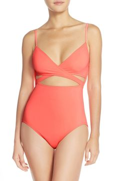 Keeping cool with this eye-catching one-piece swimsuit in bright coral from Vince Camuto.