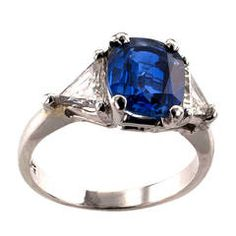 2.21 Carats Cushion Shaped Sapphire Diamond Platinum Ring | From a unique collection of vintage engagement rings at https://www.1stdibs.com/jewelry/rings/engagement-rings/