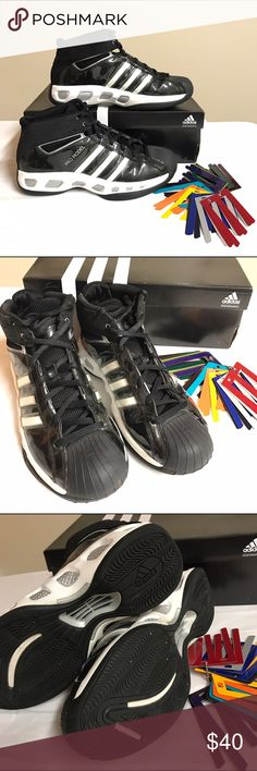 """Men's Adidas Team Color basketball shoes Men's Adidas """"Team Color"""" basketball shoes, black and white, includes 12 """"team colors"""" inserts (you insert these through the inside of the shoes where you see the white stripes it will replace white with the color you choose). Inserts colors are red, silver, blue, black, yellow, orange, teal, plum, purple, olive, green, and maroon. Very good used condition. My son wore these only a handful of times in basketball courts so the bottom soles don't have…"""