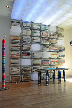 Children's toy storage, transformed into very cool book-case and lighting studio.  MOMMO DESIGN STUDIO