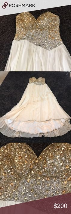 Just in time for prom!!! A 1 of a kind just for u! Can you say couture? This one of a kind formal was worn to 1 prom and my daughter won princess that night. It is so pretty, I shelled out the $$$ to buy it. It will be professionaly cleaned, and whatever else needs to be done to it so it's ready to wear! Terani Couture Dresses Prom
