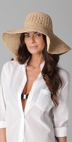 A broad-rimmed hat is essential for spending days at the beach, relaxing after the wedding