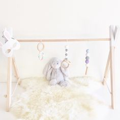 A personal favorite from my Etsy shop https://www.etsy.com/au/listing/289305439/wooden-baby-playgym-handmade-with