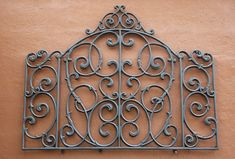 A decorative raw iron embellishment on a texturized wall.