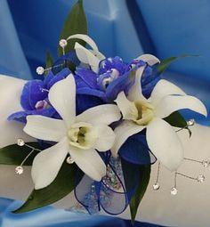 P18 Blue delphinium and white orchid wrist corsage.