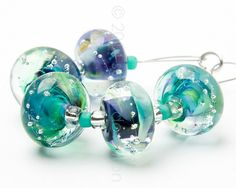 Bluish-green beads clear