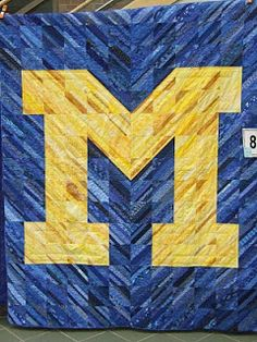 Block M string quilt   ...interesting idea to make contrasting letters on a quilt – for a person's initial, or for a school...