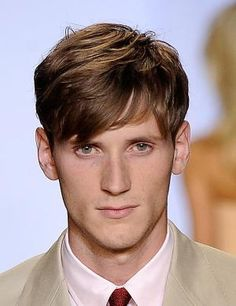 Men's Hairstyles - Men's Short Hairstyles - Pictures of Men's Hairstytles - I love men's hairstyles that are long on the top and short on the sides. It allows more versatility but also keeps you tidy and neat looking if need be. Some of my favorite men's short hairstyles are seen in this photo gallery.: Men's Long on Top Hairstyle #1
