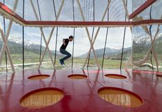 This Four-Story Crystal Playground Boasts a Trampoline With Alpine Views | Mental Floss