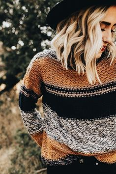Love this tan, black and white striped sweater.