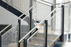 Brampton School PC Tigris is rigid stainless steel mesh used as balustrade infill panel.  The textile like structure of the mesh and reflectance of light transforms this area of the school into an attractive space.  A 65% opening on the mesh provides plenty of visibility through the mesh to minimise any interruption of view inside this room.  The curved mesh panels follow the shape of the stair case structure creating a robust but elegant balustrade.