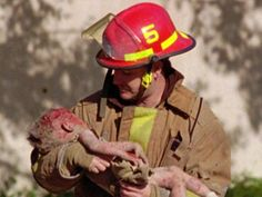 Firefighter Chris Fields carries 1-year-old Baylee Almon from the Alfred Murrah Federal Building, site of the 1995 Oklahoma City bombing. ---- photo: Charles H. Porter IV, AP