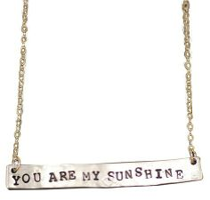 The message on this hand-stamped silver necklace makes for a sunny mood, even if the weather is bad, $45 at Pop City.