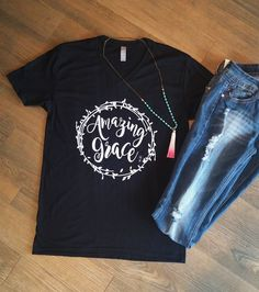 Saved by His Amazing Grace! This soft tee has a cute and comfy boyfriend cut that makes it the perfect shirt to throw on with a pair of jeans and still look put together! Super cute on it's own or style with a plaid Cute Shirt Designs, Vinyl Shirts, Tee Shirts, Christian Clothing, Cute Tshirts, Western Shirts, Amazing Grace, Shirts With Sayings, Workout Shirts