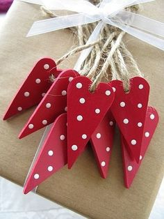 hearts with polka dots hanging on string. simply and sweet.