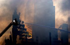 Firemen continue to fight the fires that sprout up from within the rubble of the World Trade Center in this September 19, 2001 file photo. (REUTERS/PA2 Tom Sperduto/US Coast Guard)