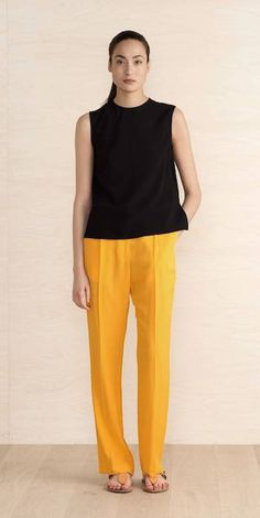 not sure about the yellow pants- but love the shapes and the black + color here