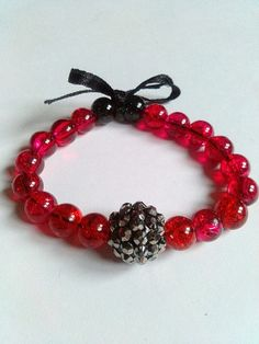 Pretty red and black beaded stretch bracelet by KaisCards on Etsy, £5.00