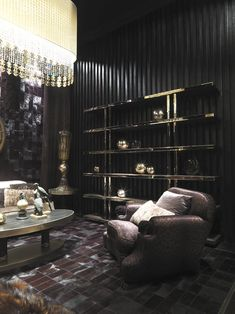 Roberto Cavalli Home-love chandelier and dark walls!