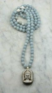 The Serenity Mala Necklace is made from 108 aquamarine mala beads. It is completed with a Buddha pendant. Buddhist prayer beads for calming and soothing.