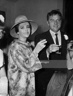 Actors Elizabeth Taylor and Richard Burton (1925 - 1984) attend the wedding of David Archer and Caroline Cook.
