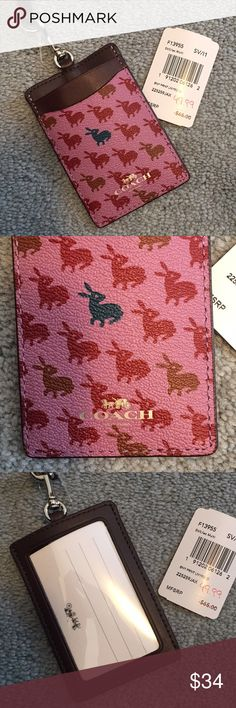 NWT Coach bunny print leather ID holder Adorable pink and red printed leather ID holder. Perfect for new grads starting a job or anyone who loses things! Pictures on blue carpet show exact placement of blue bunny   Smoke free home; open to reasonable offers Coach Accessories Key & Card Holders